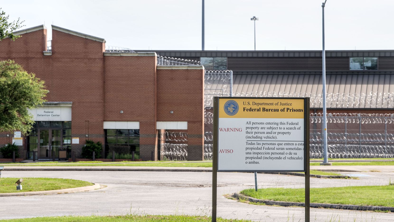 The Federal Correctional Institution, where there has been an outbreak of COVID-19, is shown from Highway 175 on Monday, July 13, 2020 in Seagoville, Texas. (Jeffrey McWhorter/Special Contributor)