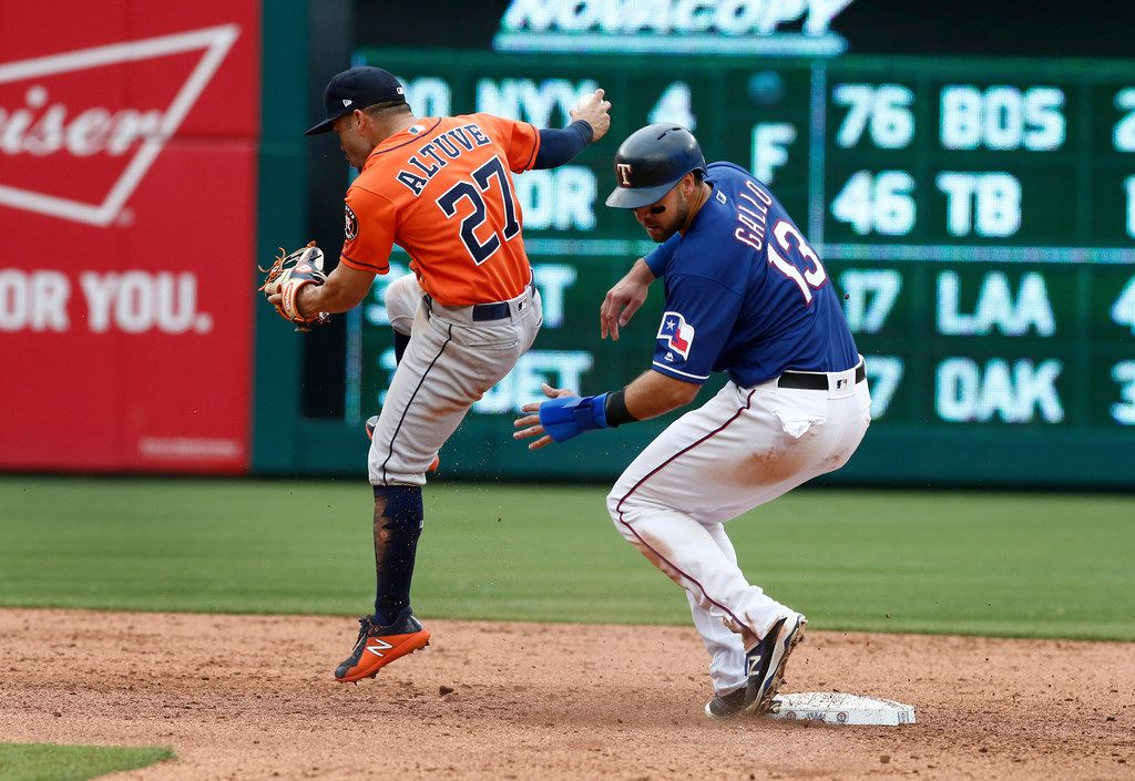 Houston Astros second baseman Jose Altuve (27) beats Texas Rangers' Joey Gallo (13) to second base for the out to end the eighth inning of a baseball game Sunday, April 1, 2018, in Arlington, Texas. (AP Photo/Mike Stone)