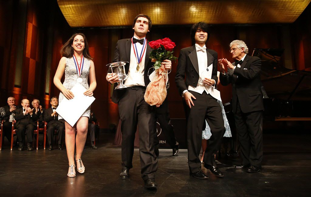 Van Cliburn International Piano Competition winners Beatrice Rana, 20, of Italy (Silver Medal), Vadym Kholodenko, 26, of Ukraine (Gold Medal) and Sean Chen, 24, of United States (Bronze Medal) walk to the front of the stage after their awards presentation at the Bass Performance Hall in Fort Worth in 2013.