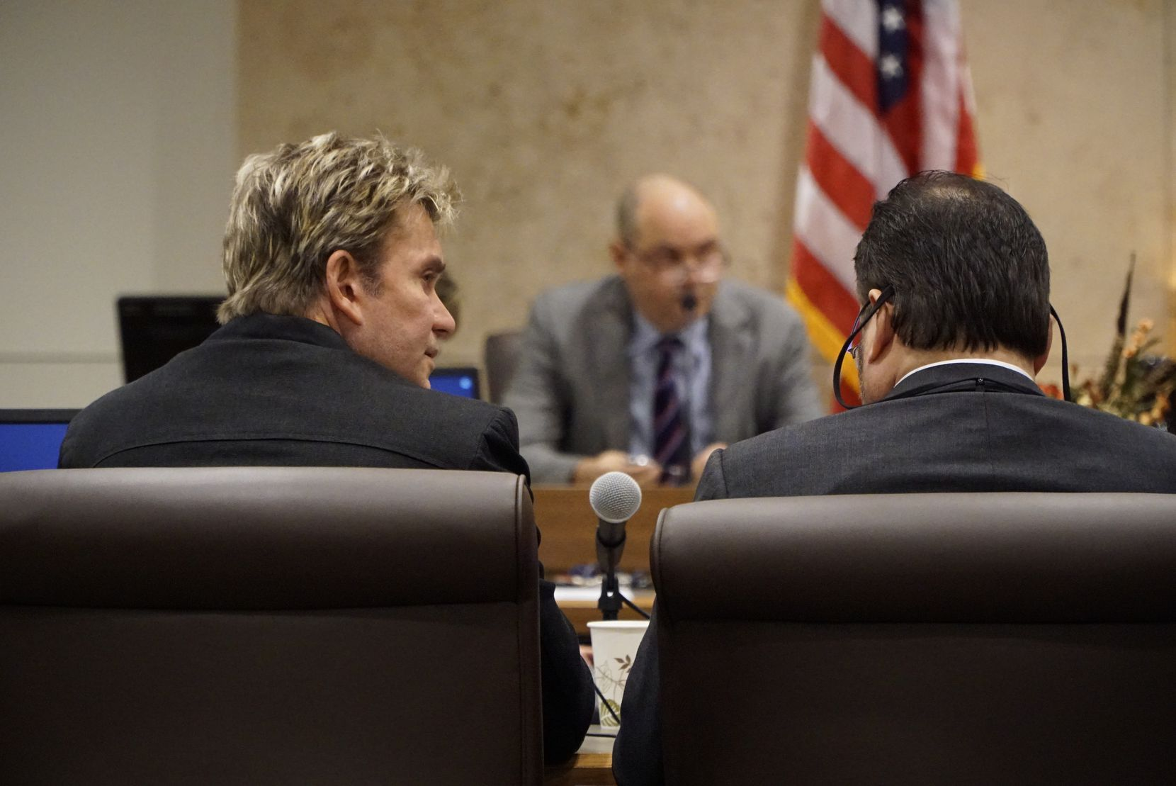 Vic Mignogna, left, sits beside attorney Ty Beard during a hearing in the 141st state District Court at the Tom Vandergriff Civil Courts Building in Fort Worth on Thursday.