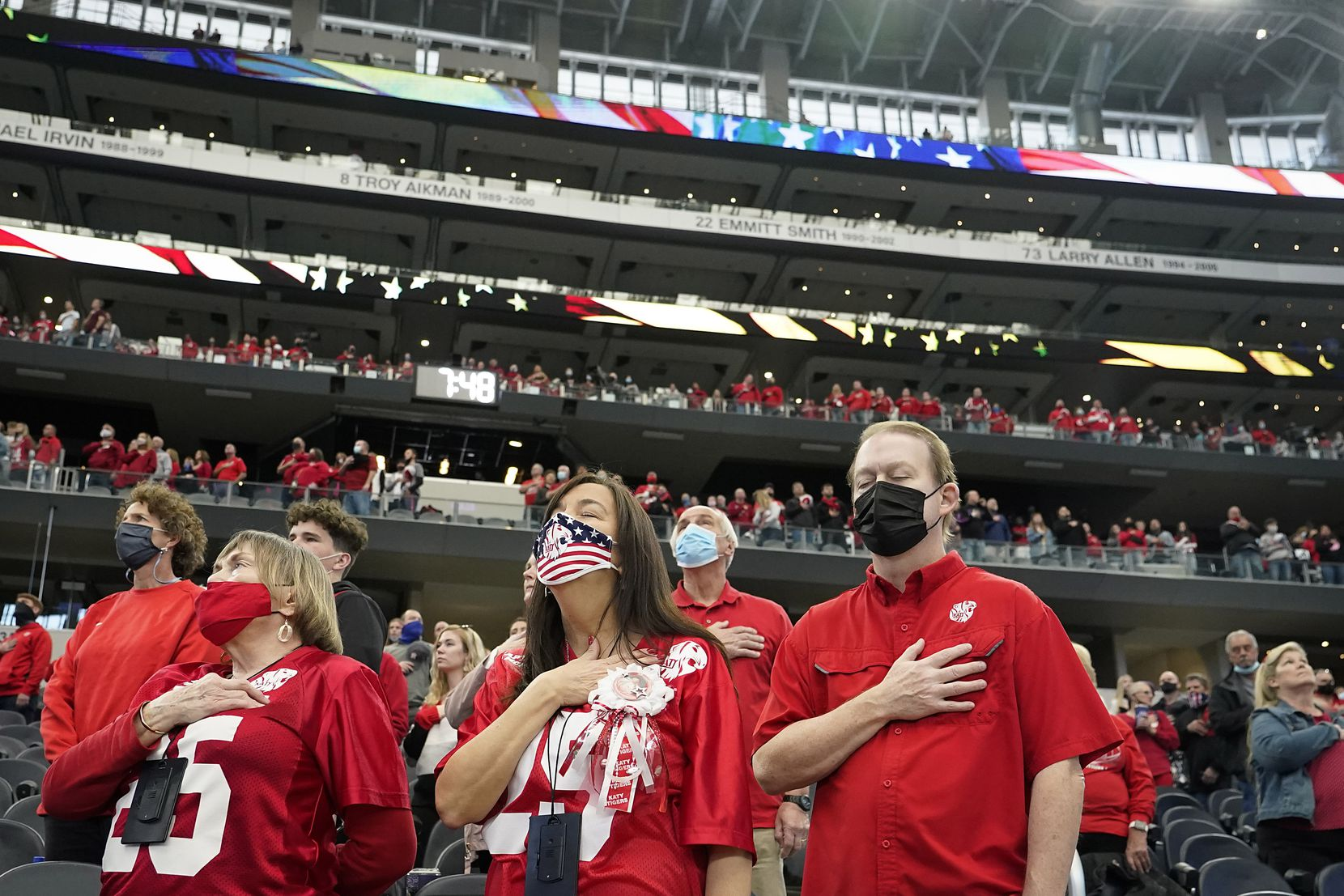 Katy fan stand for the national anthem before the Class 6A Division II state football championship  game against Cedar Hill at AT&T Stadium on Saturday, Jan. 16, 2021, in Arlington, Texas.
