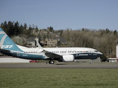 A Boeing 737 MAX 7 takes off on its first flight, Friday, March 16, 2018, in Renton, Wash. (AP Photo/Jason Redmond)