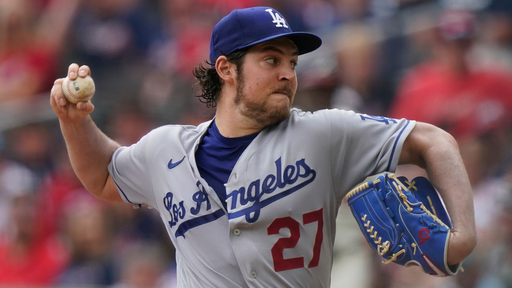 Los Angeles Dodgers starting pitcher Trevor Bauer (27) delivers in the first inning of a baseball game against the Atlanta Braves on Sunday, June 6, 2021, in Atlanta.