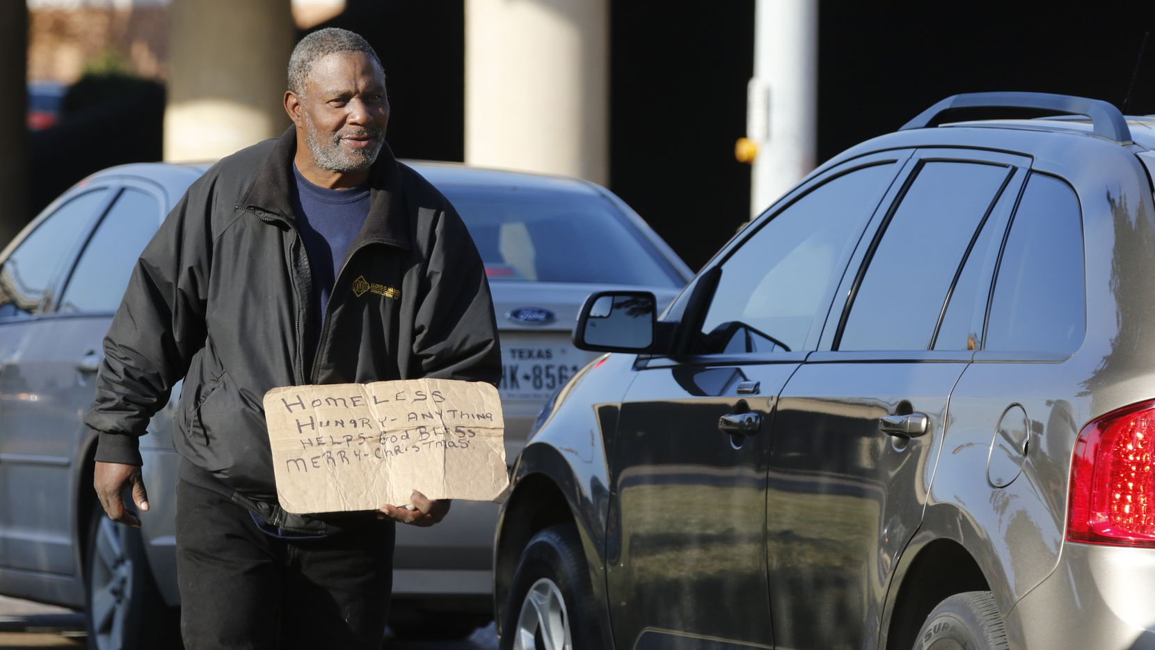 Louis Harris, 57, and homeless, panhandles at the intersection I-35E and Market Center in Dallas on Monday, December 12, 2016. He said he is homeless. (David Woo/The Dallas Morning News)