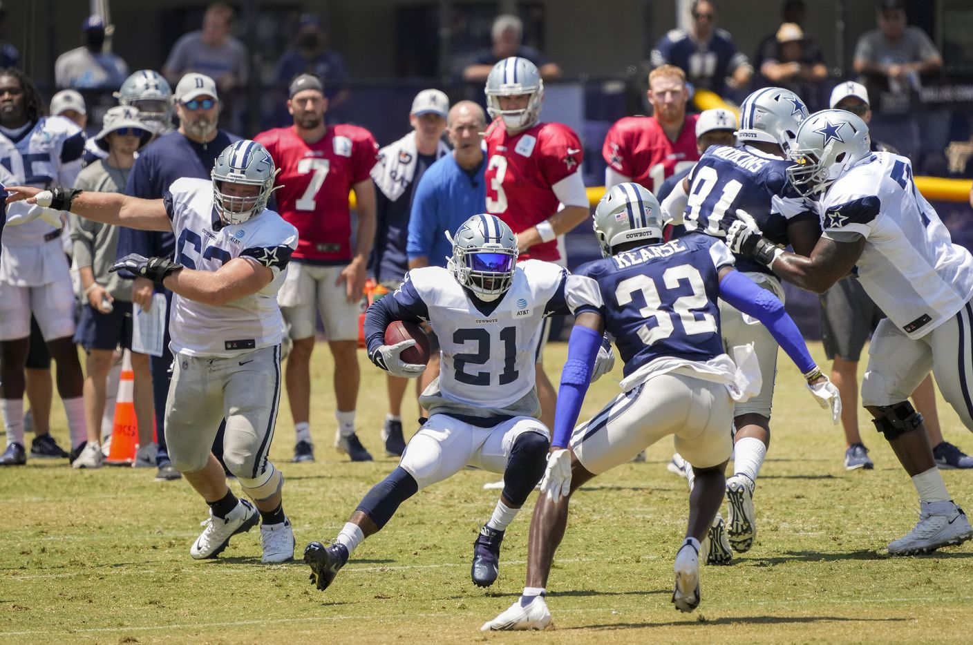 Dallas Cowboys running back Ezekiel Elliott (21) finds room to run as safety Jayron Kearse (32) closes in during a practice at training camp on Wednesday, July 28, 2021, in Oxnard, Calif.