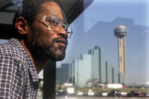This Sept. 27, 2002 file photo shows Wiley Fountain after he spent 15 years in prison for a rape he didn't commit, as he waits for his sister to pick him up from the Lew Sterrett Justice Center in Dallas, Texas.