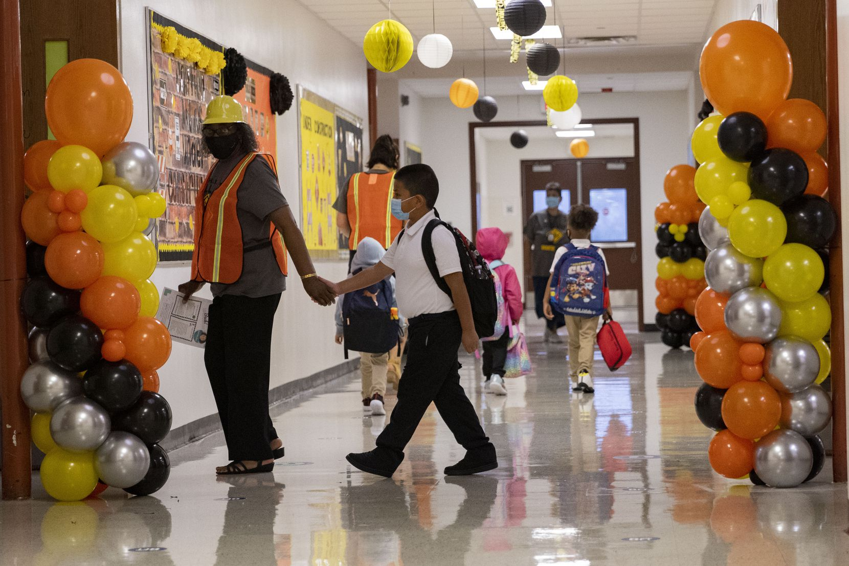 Students and teachers during the first day of school on Aug. 2, 2021, at H.I. Holland Elementary School in Dallas. Many parents are concerned statewide about the inability of individual districts to mandate masks.