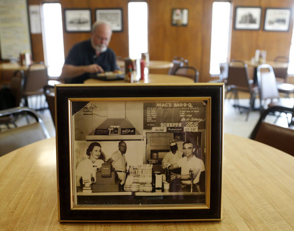 1957 photo of Effie White (left), Bill H. McDonald, Mr. Charlie and Mr. Brown at a former location, pictured at the current location of Mac's Bar-B-Que. (File Photo/The Dallas Morning News)