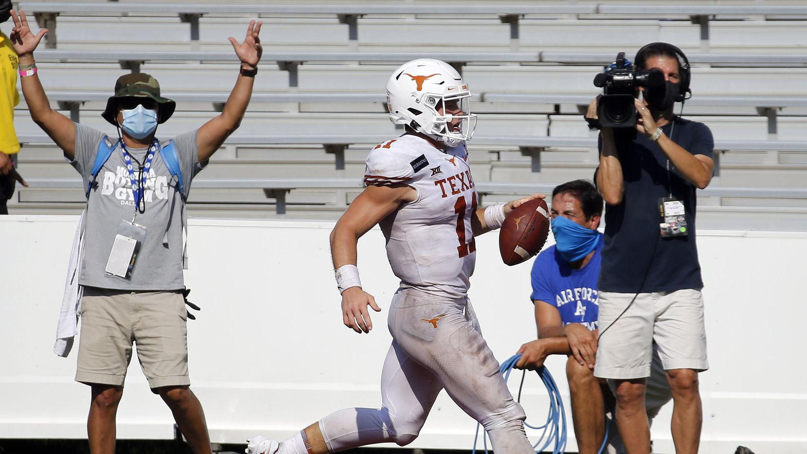 Texas Longhorns quarterback Sam Ehlinger (11) runs in a touchdown during the second overtime against the Oklahoma Sooners in the Red River Rivalry at the Cotton Bowl in Dallas, Saturday, October 10, 2020. Oklahoma won in quadruple overtime, 53-45.