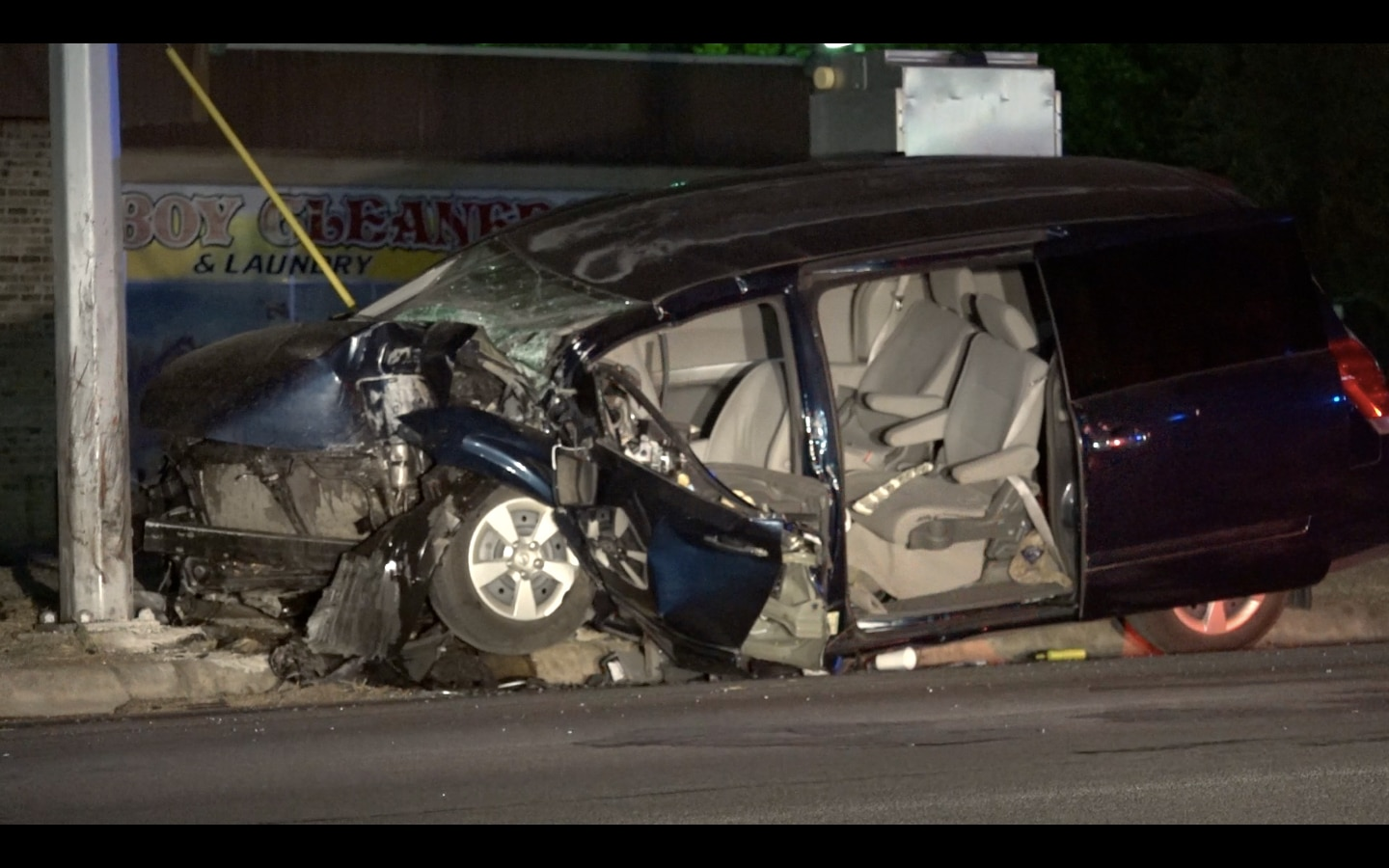 A minivan was left crumpled after it hit a utility pole Tuesday morning in Fort Worth. Two occupants were expected to survive their injuries, police said,