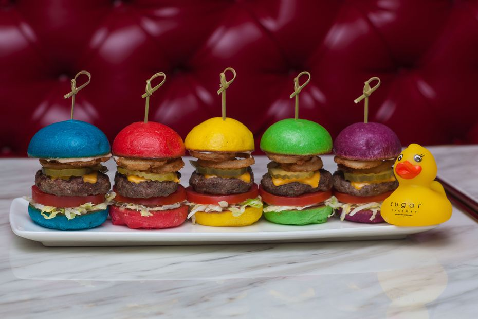 The Rainbow Sliders, an appetizer for $25 at Sugar Factory, are a colorful array of little cheeseburgers.