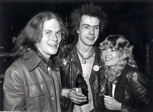 """Sid Vicious, flanked by Buddy staffers Ben Ferguson and Bobette Riner, when the Sex Pistols played the Longhorn on January 10, 1978. Kirby Warnock, former editor at Buddy, said that once owner Dewey Groom heard what he's gotten himself into, he """"tried to get out of the show, but he'd already signed the contract."""" (Courtesy Kirby Warnock)"""