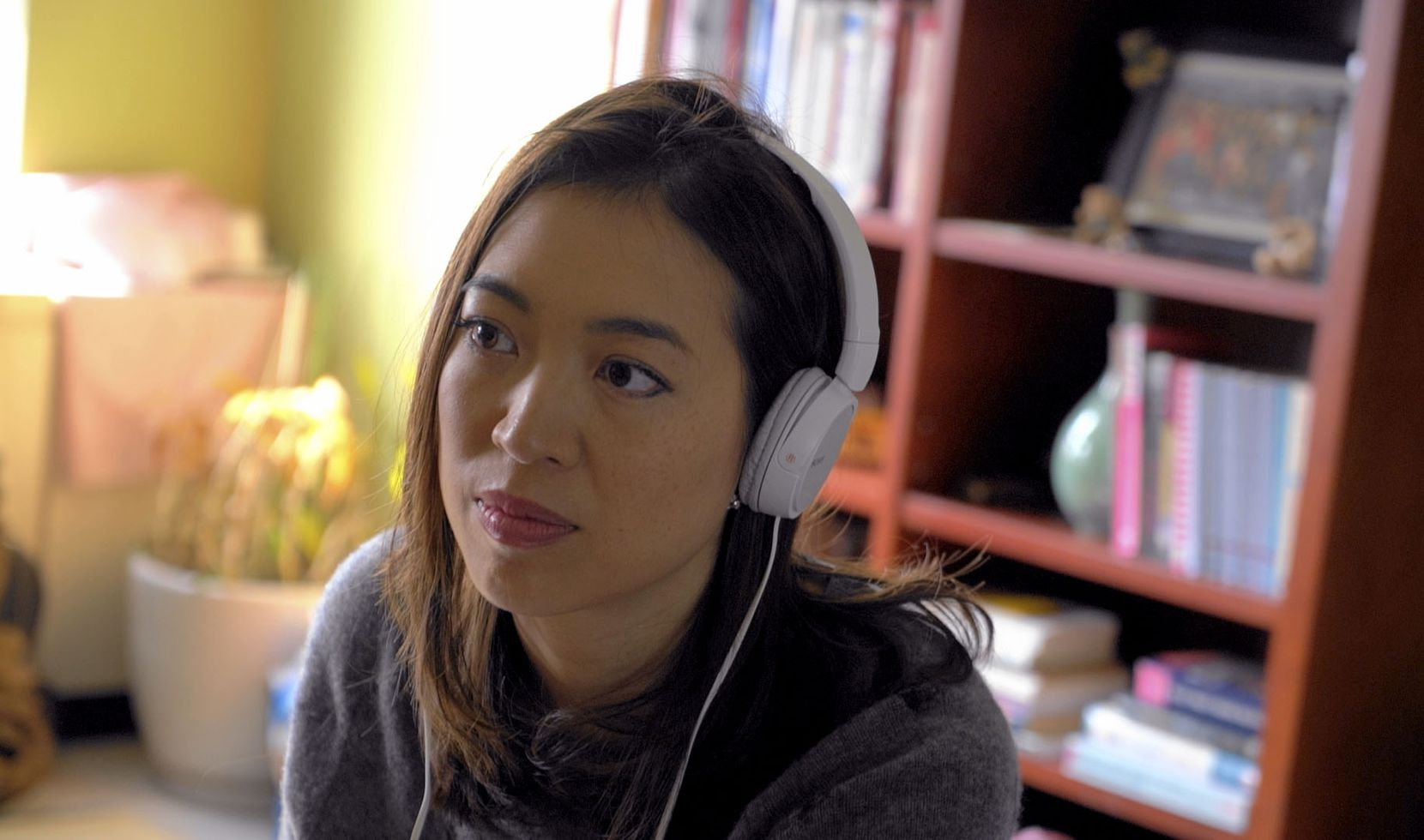 Elise Hu, NPR reporter, conducts an interview from her apartment in Seoul, South Korea.