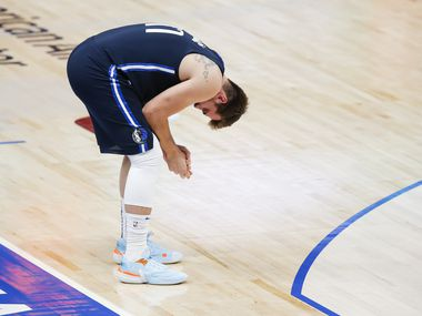 Dallas Mavericks guard Luka Doncic (77) reacts after missing two back-to-back three-point shots during the second half of an NBA basketball game against the Philadelphia 76ers in Dallas, Monday, April 12, 2021.