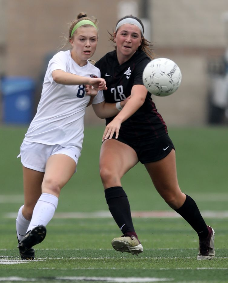 Wakeland's Brooke Hartshorn (8) and Dripping Springs' Taylor Hodsden (28) chase after the ball during their UIL 5A girls State championship soccer game at Birkelbach Field on April 16, 2021 in Georgetown, Texas.  (Thao Nguyen/Special Contributor)