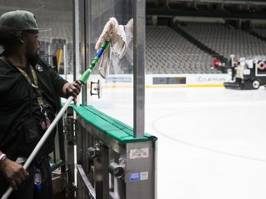 Lonnie Lockhart and other crew members clean and prepare to cover the Dallas Stars ice after the NHL season was put on hold due to coronavirus on Thursday, March 12, 2020 at American Airlines Center in Dallas.
