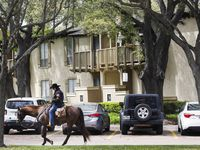 Horseback security guard Staci Smith patrols The Village apartments Wednesday, April 1, 2020 in Dallas.