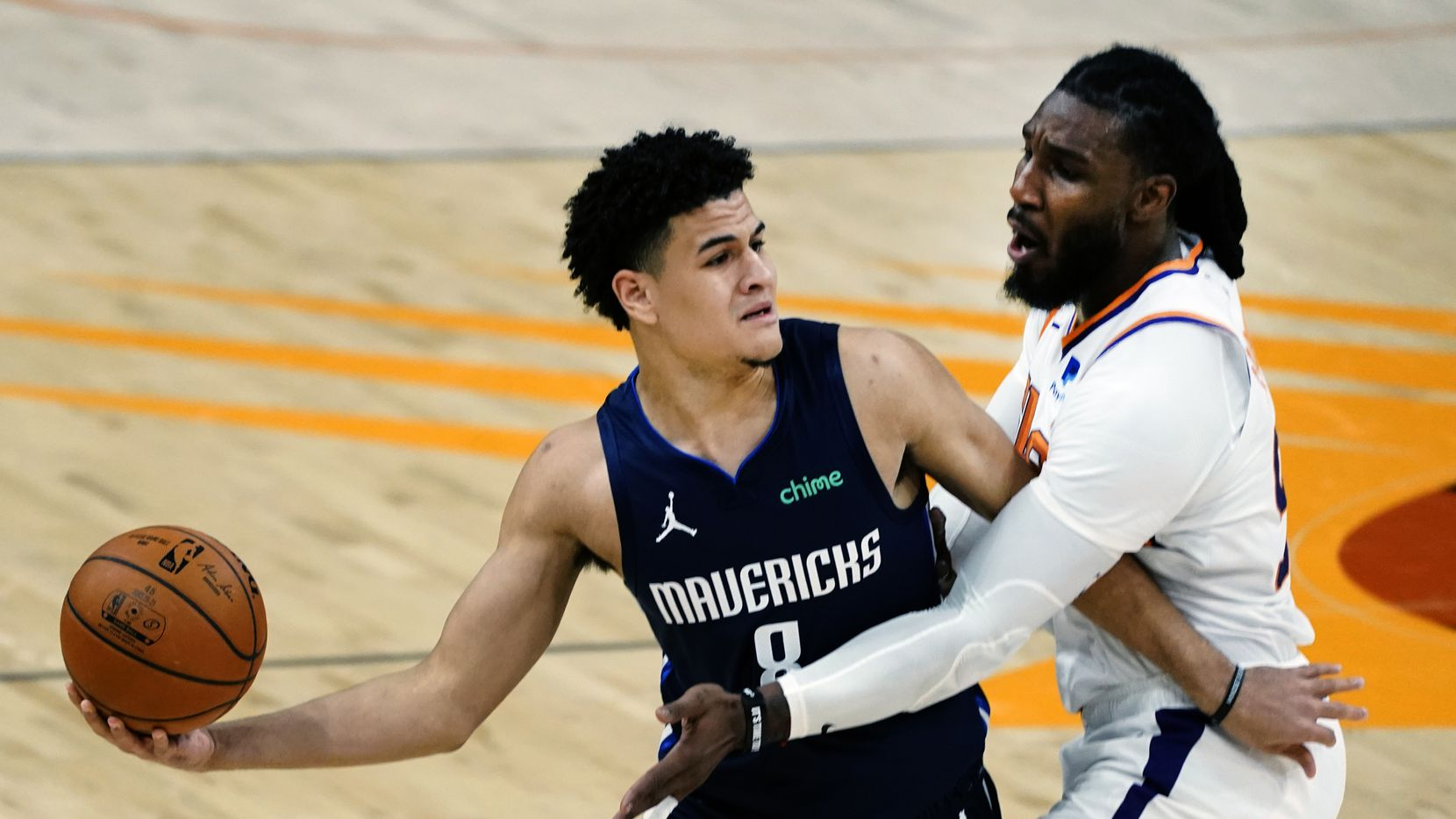 Phoenix Suns forward Jae Crowder pressures Dallas Mavericks guard Josh Green during the first half of an NBA basketball game Wednesday, Dec. 23, 2020, in Phoenix.
