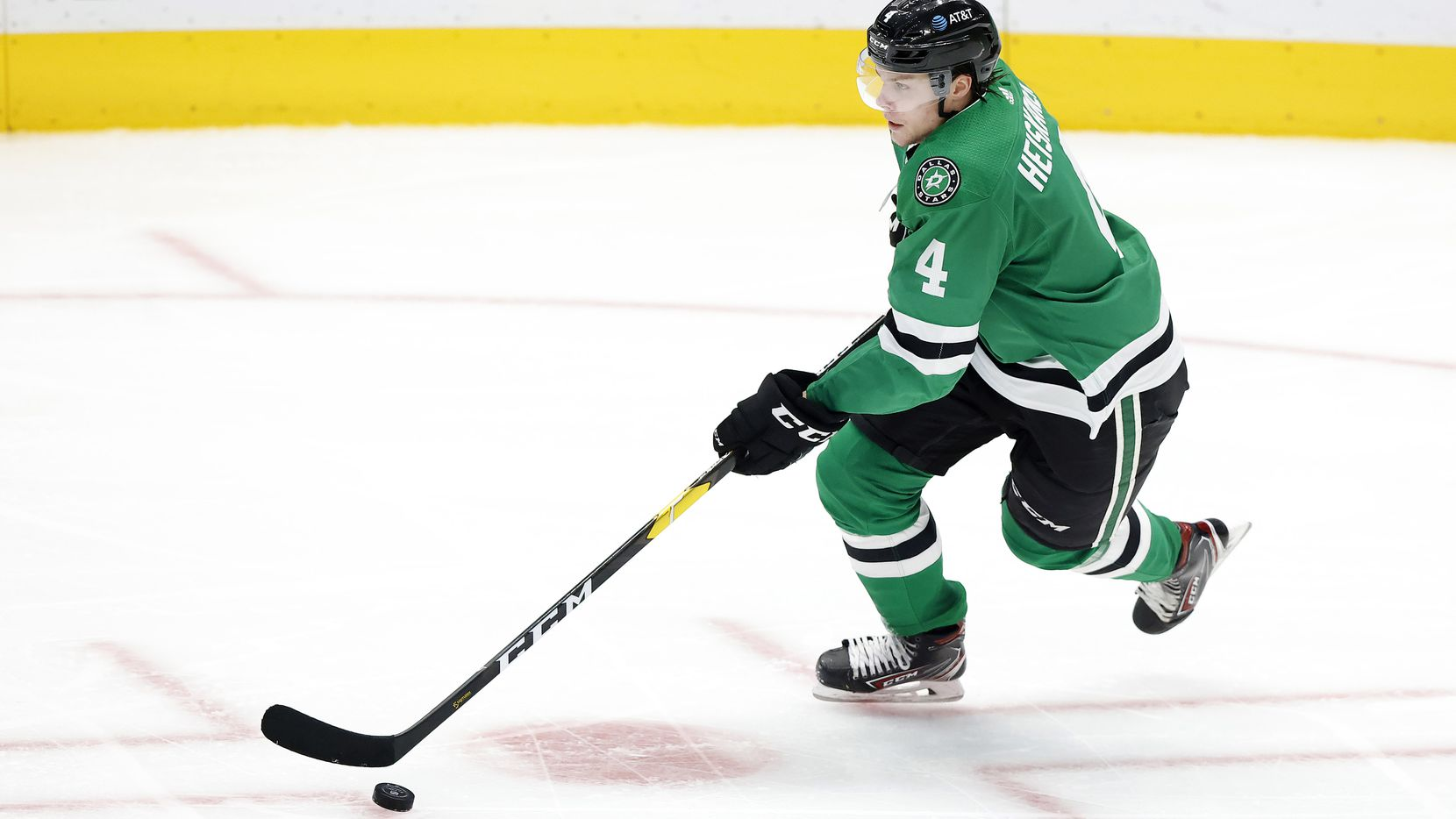 Dallas Stars defenseman Miro Heiskanen (4) brings the puck up ice against the Columbus Blue Jackets during the third period at the American Airlines Center in Dallas, Thursday, March 4, 2021.