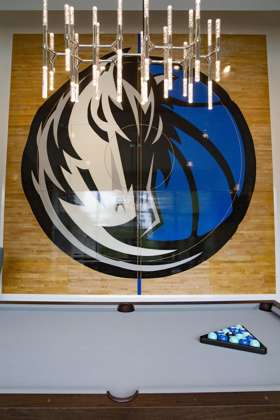Mavs super fan Mark Thompson's, owner of Smith-Thompson security company, center area of the hardwood floor from the 2011 NBA Finals on his wall at his home on Wednesday, June 9, 2021, at in Fairview.
