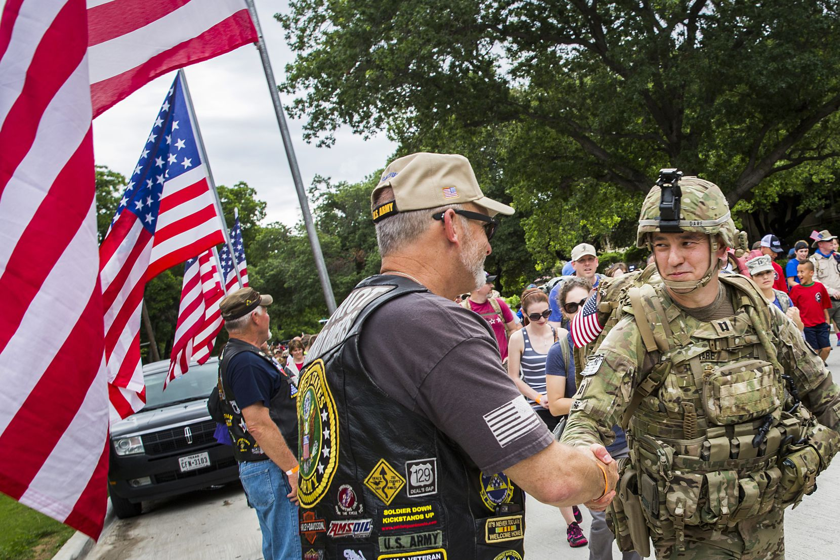 Iraq war veteran Glen Dare of McKinney (right) thanks members of the Patriot Riders who formed a color guard at the start of a previous Carry the Load Dallas Memorial March.