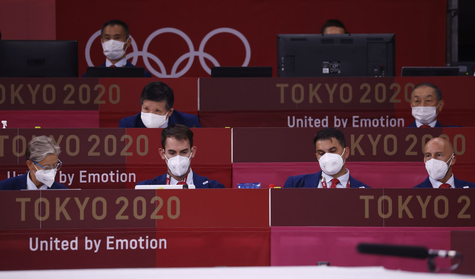 Masked officials look over the bouts during the karate men's kumite -75kg elimination round at the postponed 2020 Tokyo Olympics at Nippon Budokan, on Friday, August 6, 2021, in Tokyo, Japan. (Vernon Bryant/The Dallas Morning News)