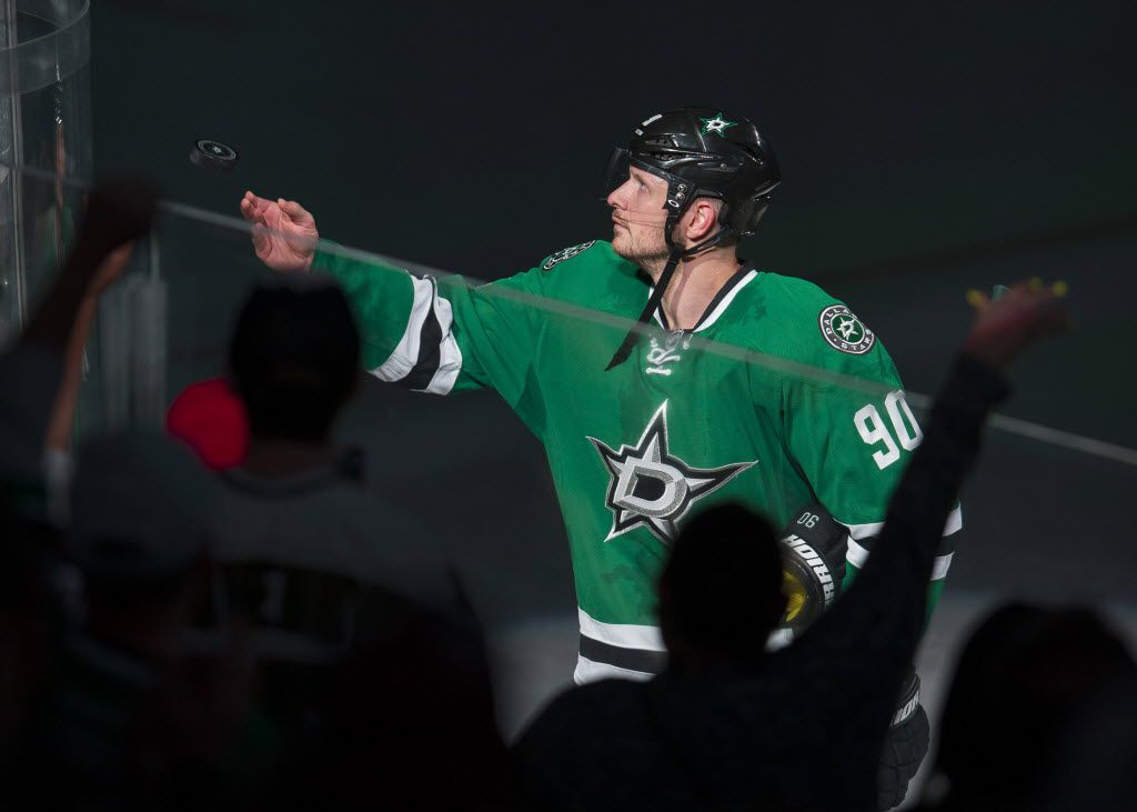 Apr 14, 2016; Dallas, TX, USA; Dallas Stars center Jason Spezza (90) throws a puck to the crowd after being named the number one star in the win over the Minnesota Wild in game one of the first round of the 2016 Stanley Cup Playoffs at American Airlines Center. The Stars shut out the Wild 4-0. Mandatory Credit: Jerome Miron-USA TODAY Sports ORG XMIT: USATSI-267940