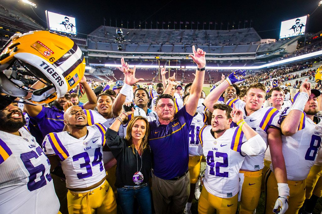 LSU head coach Ed Orgeron celebrates with his players after a win over Texas A&M in an NCAA football game at Kyle Field on Thursday, Nov. 24, 2016, in College Station, Texas.  LSU won the game 54-39. (Smiley N. Pool/The Dallas Morning News)