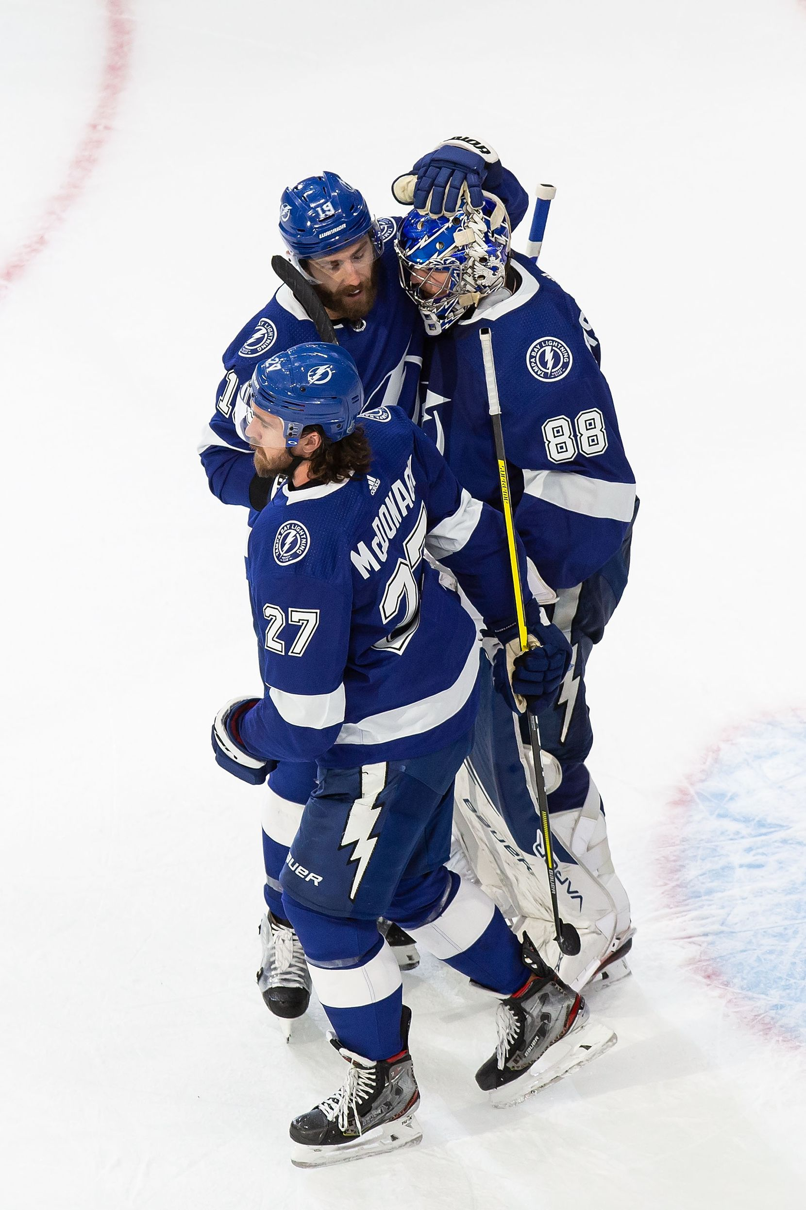 Ryan McDonagh (27), Barclay Goodrow (19) and goaltender Andrei Vasilevskiy (88) of the Tampa Bay Lightning celebrate their victory against the Dallas Stars during Game Two of the Stanley Cup Final at Rogers Place in Edmonton, Alberta, Canada on Monday, September 21, 2020. (Codie McLachlan/Special Contributor)