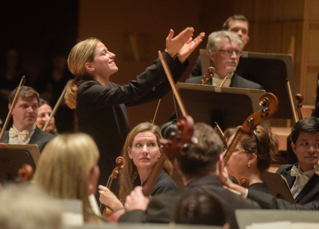 """Karina Canellakis acknowledges the soloists that played during Dallas  performance of Beethoven's """"Symphony No. 8 in F major, Op. 93"""" at the Morton H. Meyerson Symphony Center on Jan. 12, 2017."""
