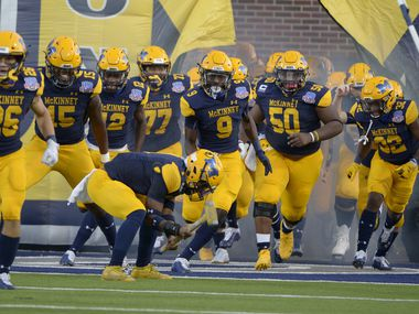 McKinney players run onto the field before a high school football game between Plano and McKinney, Friday, Sept, 25 2020, in McKinney, Texas.