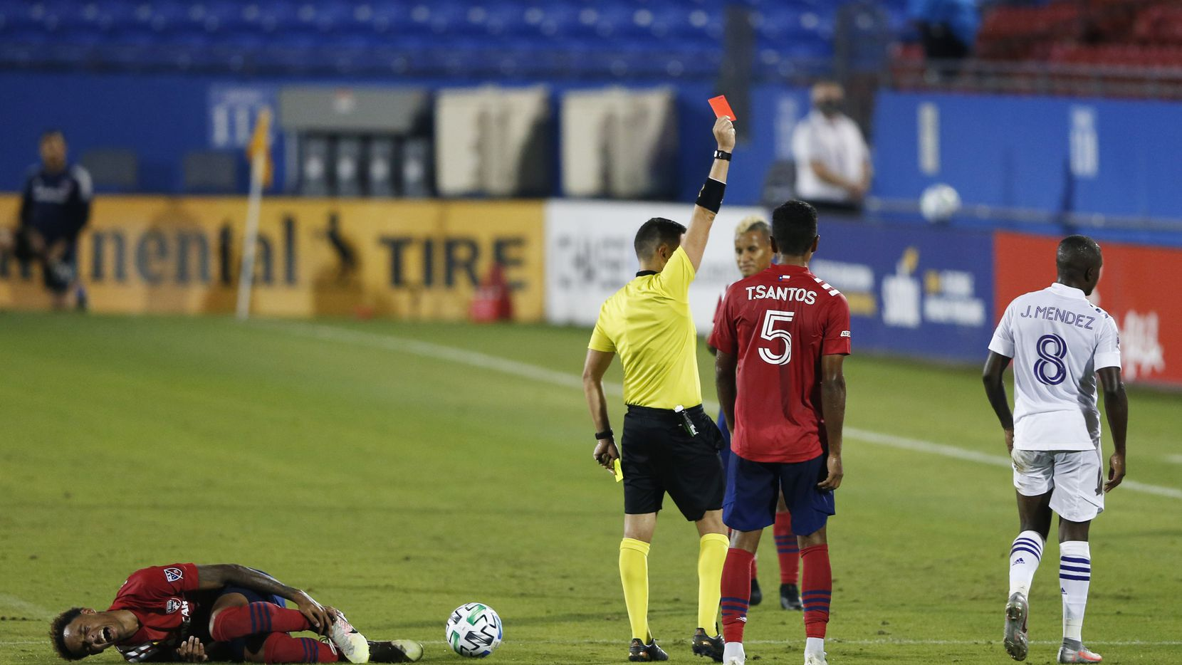 Orlando City midfielder Sebas Mendez (8) gets a red card as FC Dallas forward Bryan Reynolds (14) grabs his leg during the second half of play at Toyota Stadium in Frisco, Texas on Sunday, September 27, 2020.
