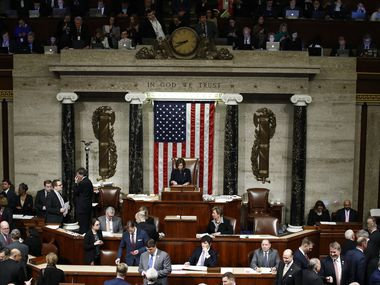 As members vote, House Speaker Nancy Pelosi of Calif., stands on the dais, during a vote on the article II of impeachment against President Donald Trump, Wednesday, Dec. 18, 2019, on Capitol Hill in Washington. (AP Photo/Patrick Semansky)