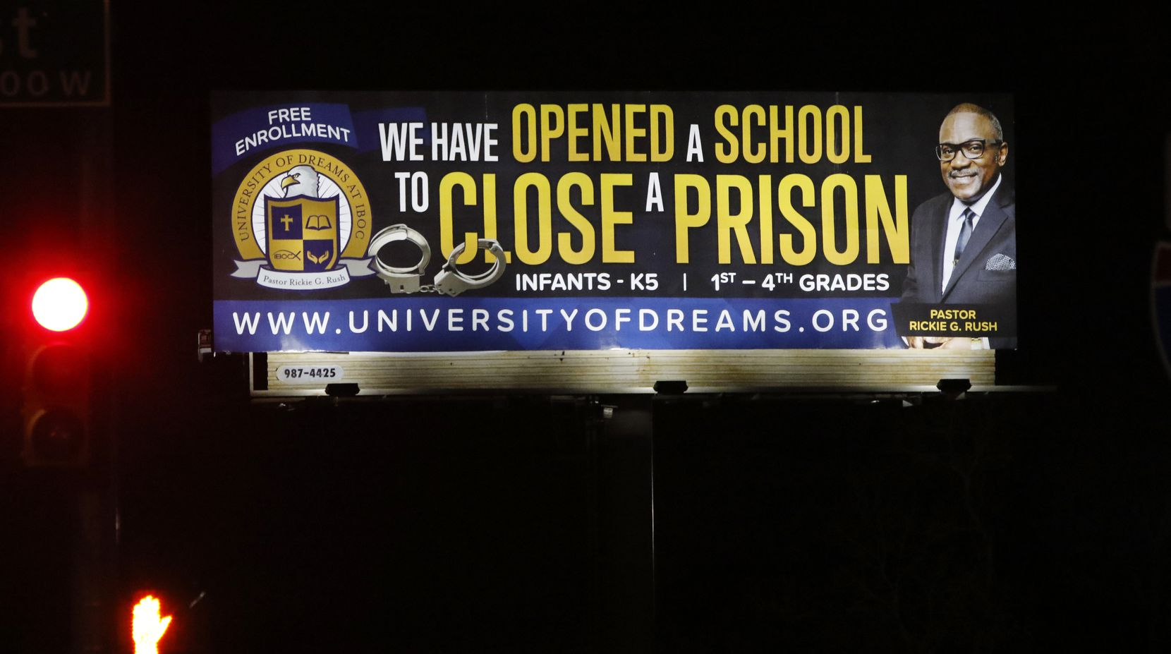 A billboard for University of Dreams, the school at Pastor Rickie Rush's Inspiring Body of Christ Church in Dallas, towers over U.S. Highway 67 at Kiest Boulevard.