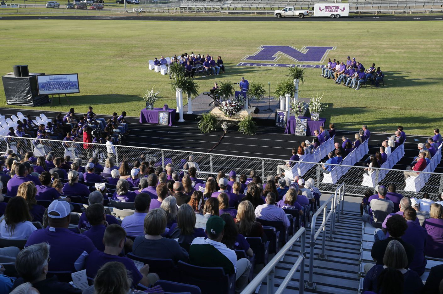 """People in attendance during the memorial service for Newton High School head football coach William Theodore """"W.T."""" Johnston at Curtis Barbay Field at Newton High School in Newton, Texas on Wednesday, May 15, 2019. (Vernon Bryant/The Dallas Morning News)"""