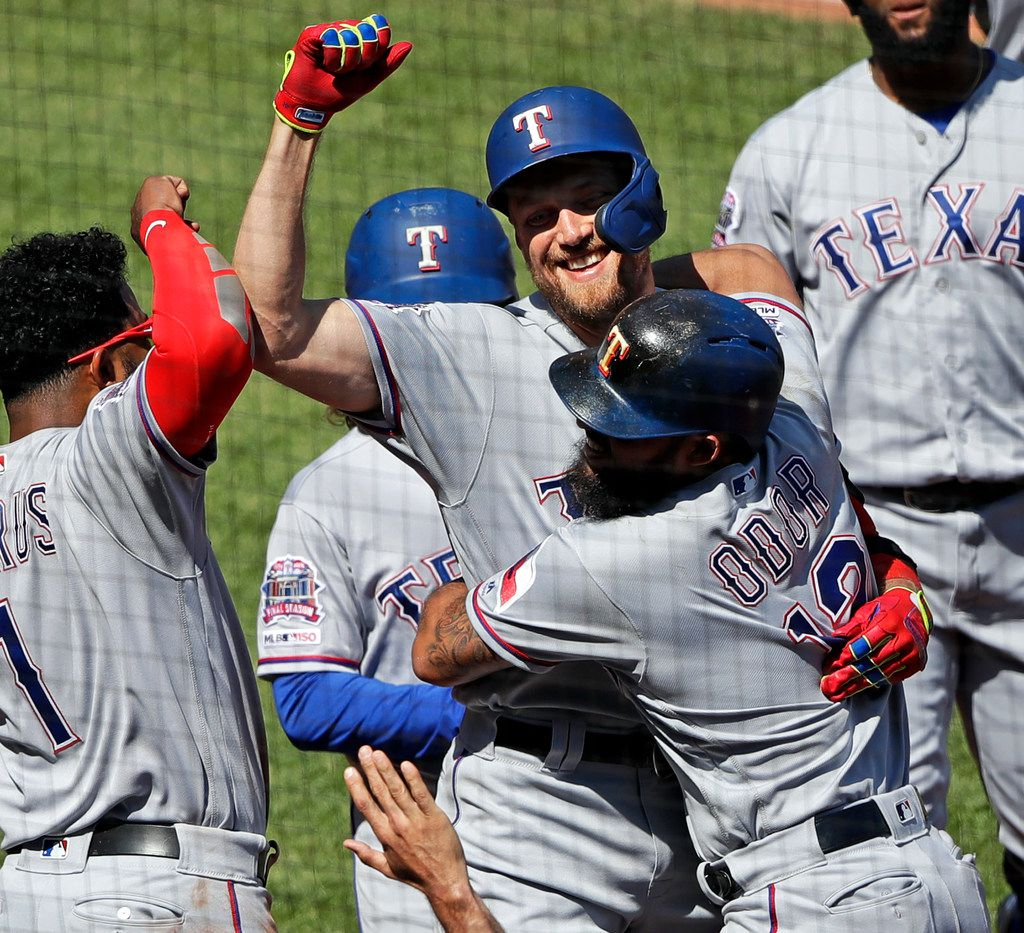 Texas Rangers' Hunter Pence, center, is congratulated by Rougned Odor (12) and Elvis Andrus (1) as he returns to the dugout after hitting a grand slam off Pittsburgh Pirates relief pitcher Michael Feliz during the eighth inning of a baseball game in Pittsburgh, Wednesday, May 8, 2019. The Rangers won 9-6.(AP Photo/Gene J. Puskar)