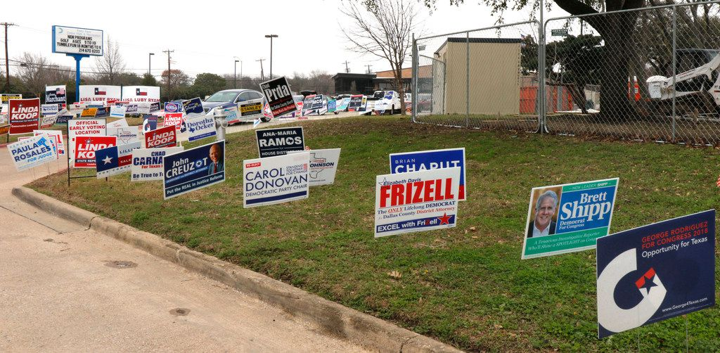 Political signs covered an area at the Fretz Park Branch of the Dallas Public Library in Far North Dallas on March 1, 2018.