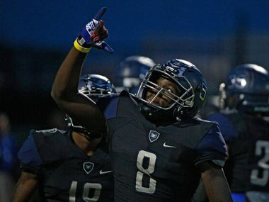 Wylie East's Eno Benjamin celebrates a  touchdown against Forney in the first half at Wylie ISD Stadium in Wylie on  Sept. 16, 2016.