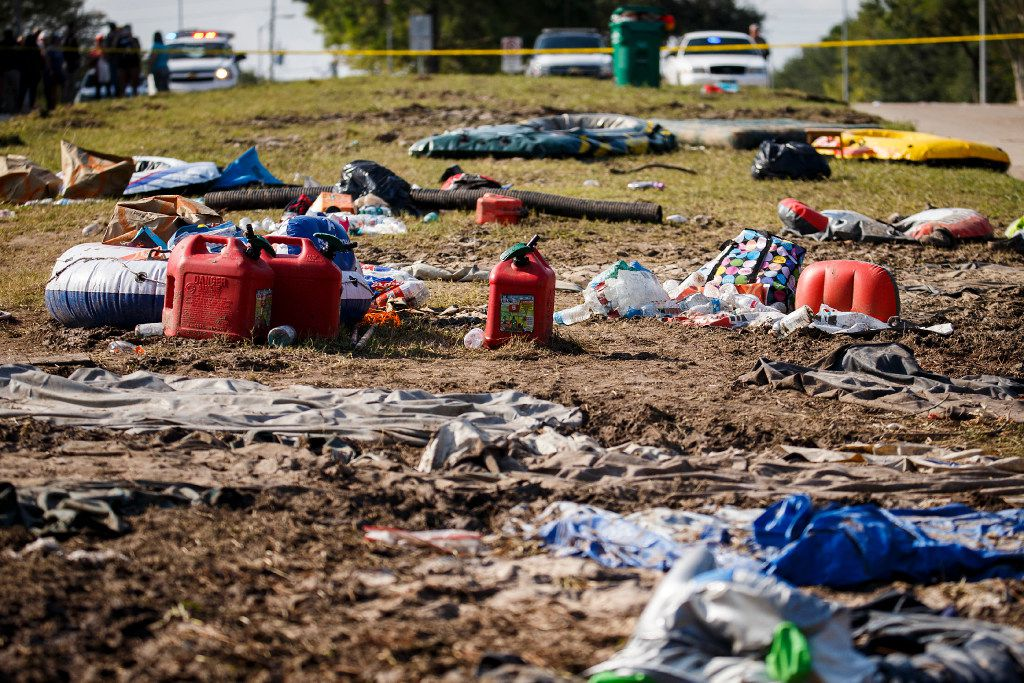 Debris left behind from the evacuation litters the median of Mason Road near the entrance to the Cinco Ranch Canyon Gate subdivision in Katy on Sept. 2, 2017.