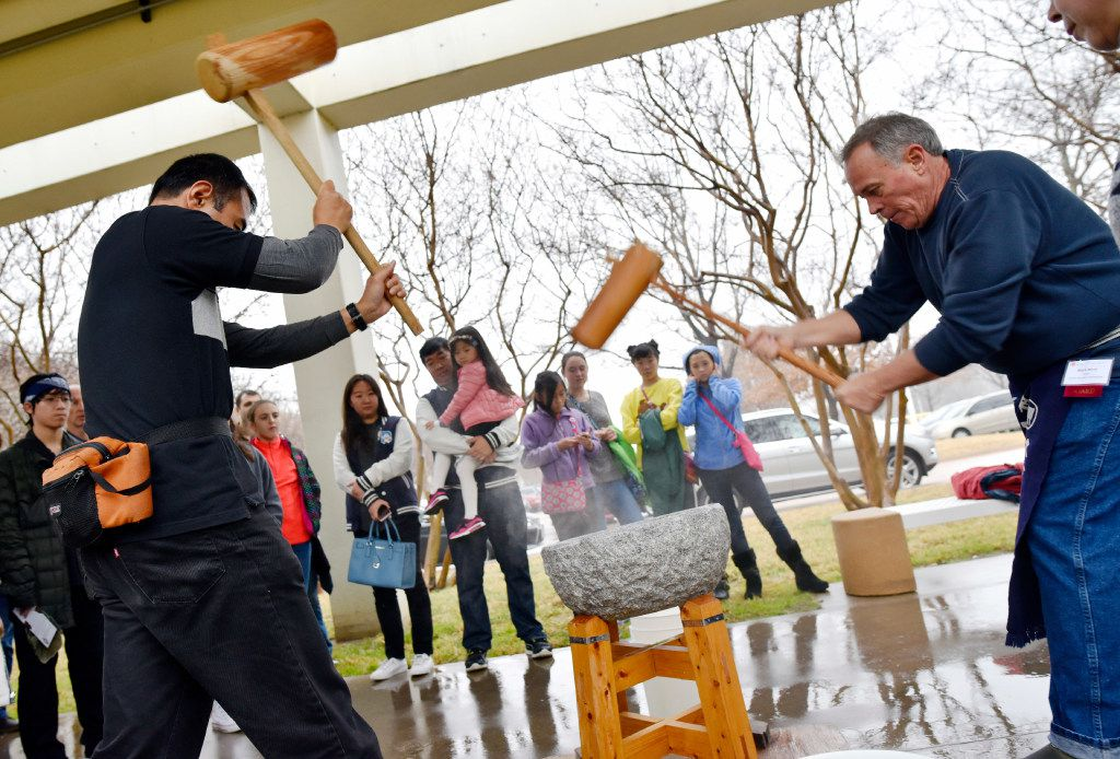 Naoki Hariyama, 46, left, and Mark Berry, 56, right, perform a rice pounding called mochitsuki at the 17th annual Mochitsuki New Year's celebration, hosted by the Japan-America Society of DFW, on Sunday, Jan. 15, 2017 at Fujitsu Network Communications in Richardson. The annual event included live performances, a Samurai and a mochitsuki. Mochitsuki is the pounding of sweet rice cakes called mochi. The sweet rice cakes are normally eaten year-round, but are a traditional New Year's treat. Ben Torres/Special Contributor