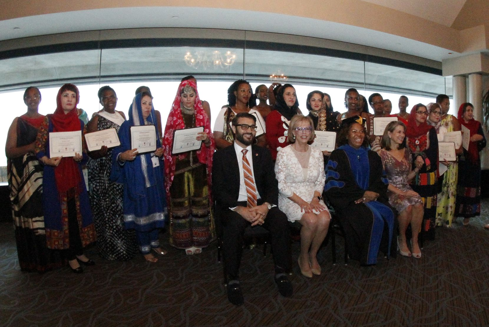 A group of women from Afghanistan and Rwanda gathered for a group photo after their graduation celebration.