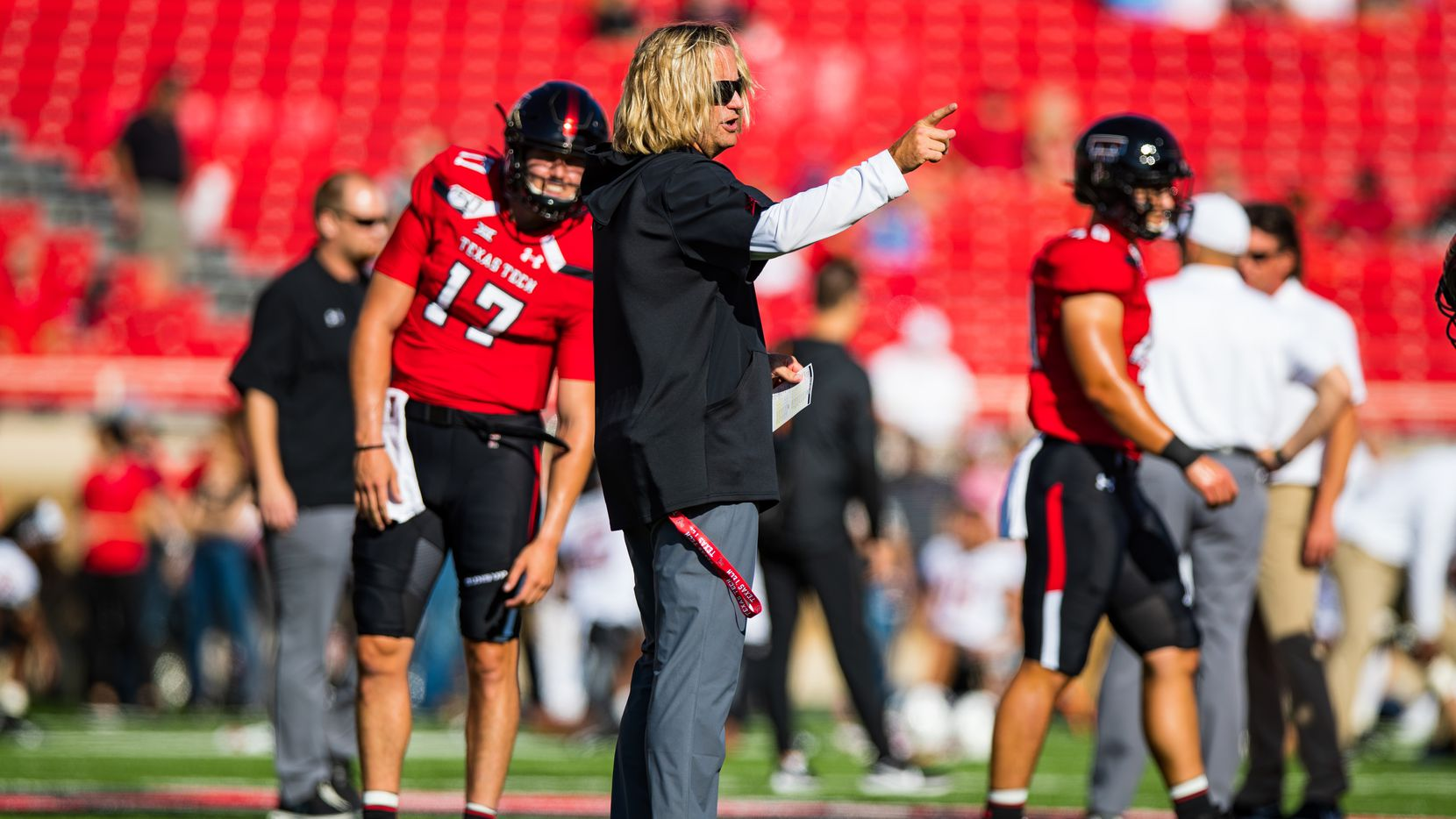 LUBBOCK, TEXAS - OCTOBER 05: Offensive coordinator David Yost of the Texas Tech Red Raiders oversees pregame warmups before the college football game against the Oklahoma State Cowboys on October 05, 2019 at Jones AT&T Stadium in Lubbock, Texas.