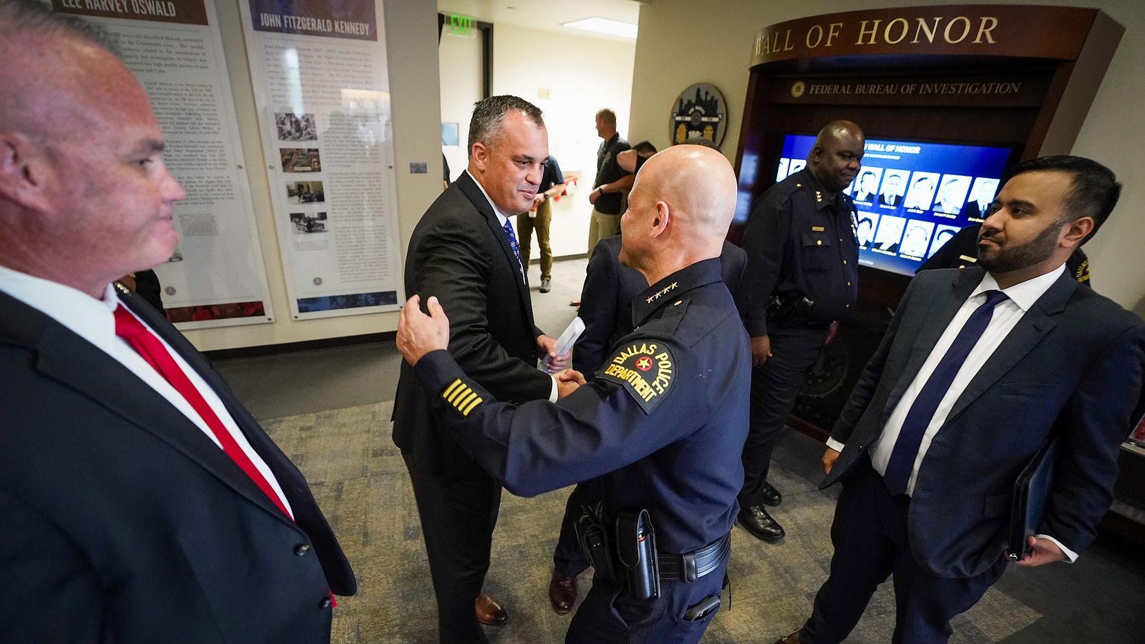 Dallas Police Chief Eddie Garcia (center) shakes hands with Special Agent in Charge Matthew J. DeSarno of FBI – Dallas after a press conference on a law enforcement action taken to address violent crime at the FBI Dallas Headquarters on Thursday, June 10, 2021, in Dallas. ATF Dallas Special Agent in Charge Jeffrey Boshek II is at left, and Acting U.S. Attorney for the Northern District of Texas Prerak Shah is at right.