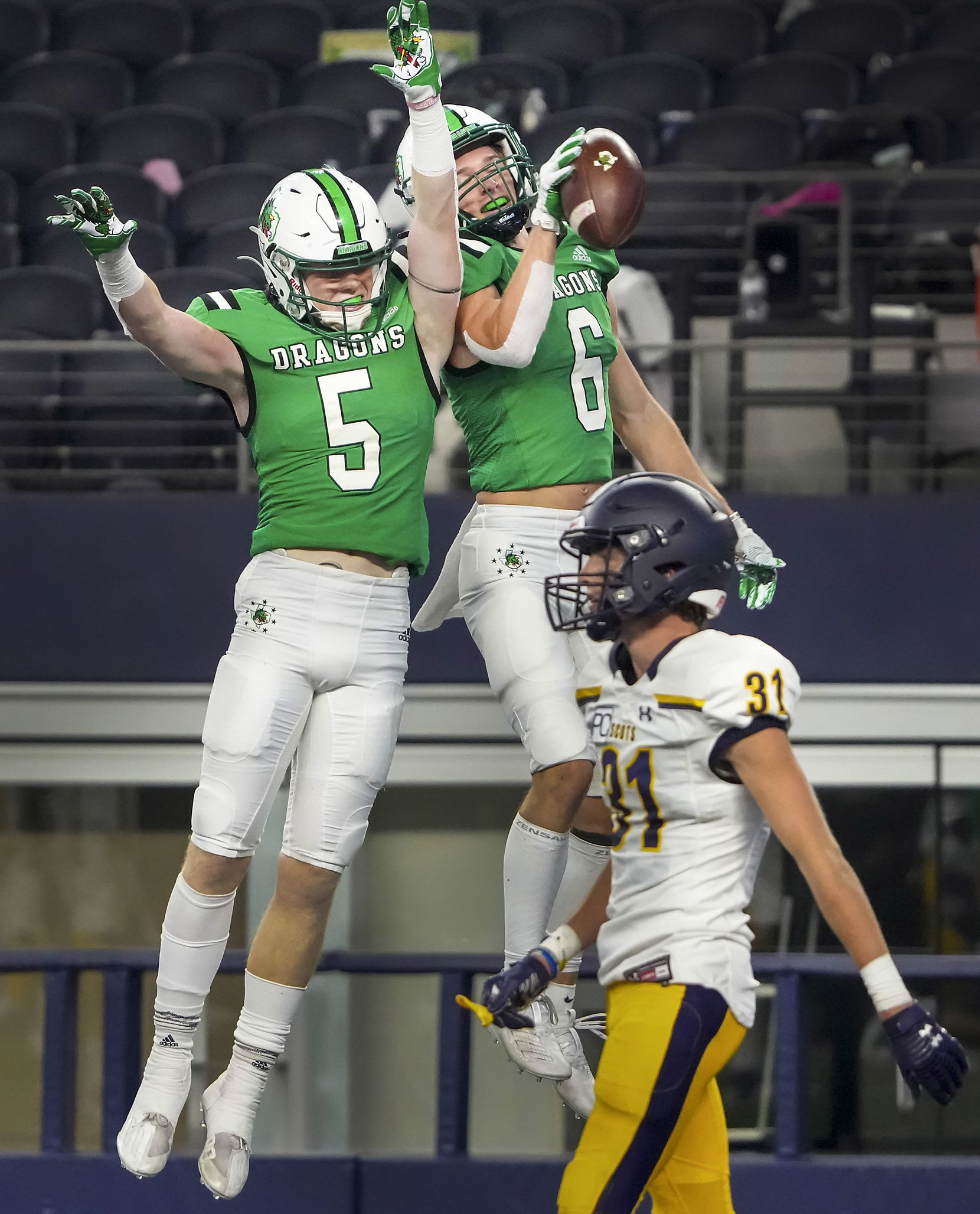 Southlake Carroll wide receiver Landon Samson (6) celebrates with Corbin Duwe (5) after scoring on a touchdown reception past Highland Park defensive back Blake Bevans (31) during the first half of a high school football game at AT&T Stadium on Thursday, Aug. 26, 2021, in Arlington.