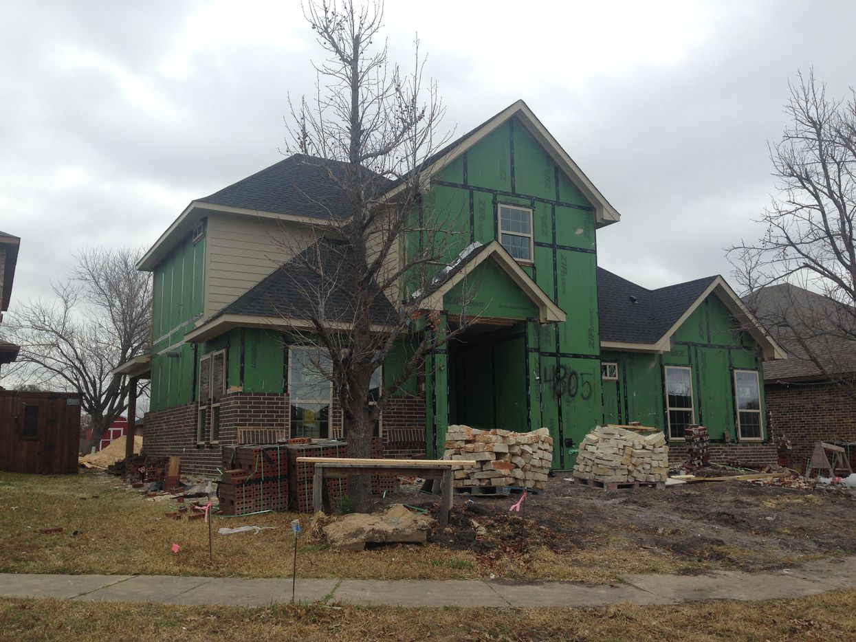 Bricks and exterior finish remained on the rebuild of a single-family residence on Crestpoint Lane in Garland on Wednesday. At a news conference held in front of the property in December 2015, the city called it the hardest-hit area of Garland.