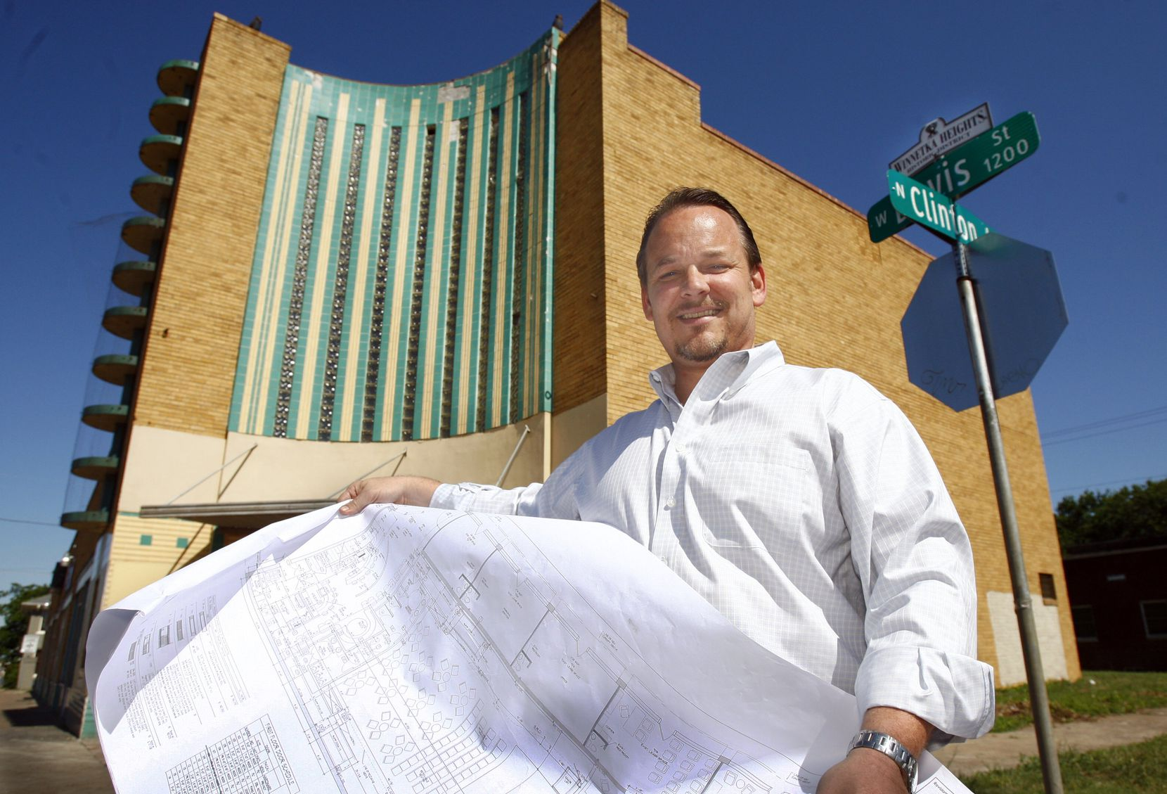 Edwin Cabaniss stood in front of the old Kessler Theater in Oak Cliff in 2009 with blueprints of the venue. Cabaniss was a driving force in helping arts organizations secure SVOG funding.
