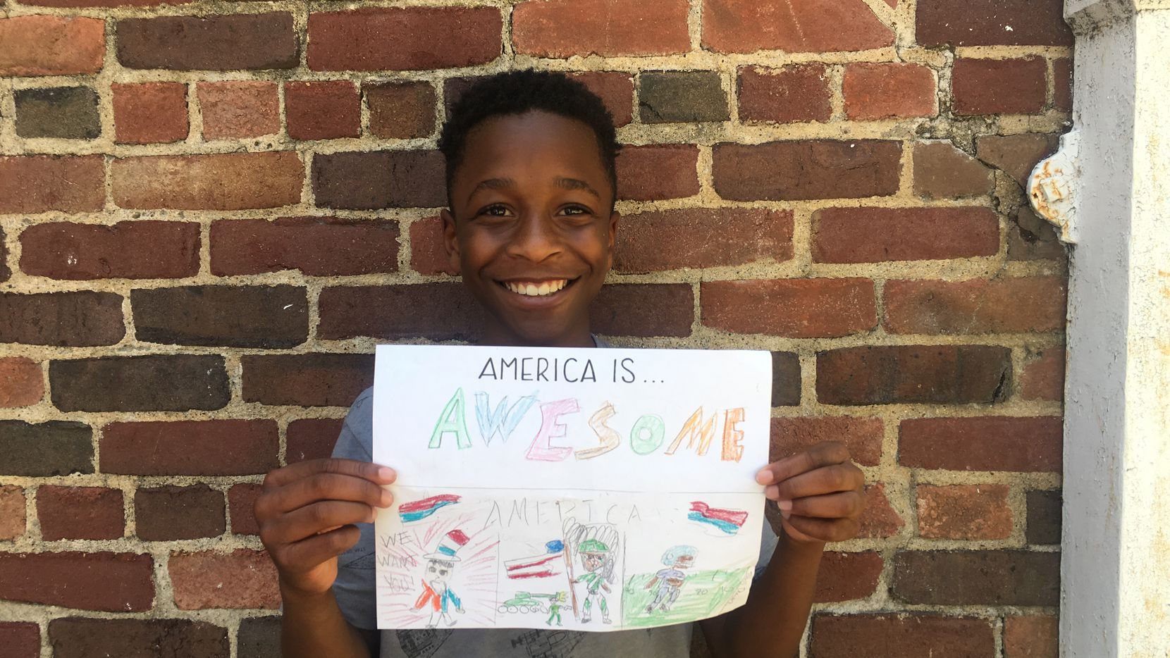 "12-year-old Brice shows off his ""America Is ..."" artwork."