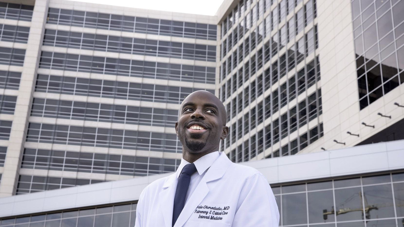 Dr. Dale Okorodudu poses for a portrait outside of the University of Texas Southwestern Medical Center's William P. Clements Jr. University Hospital on Tuesday, Feb. 2, 2021, in Dallas.