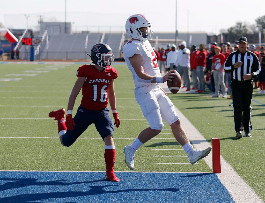 Parish Episcopal's Preston Stone (2) jumps into the end zone for a touchdown as Plano John Paul II'sJacob Turbidy (16) closes in on the play during the first half of play at the TAPPS Division I state championship game at Waco Midway's Panther Stadium in Hewitt, Texas on Friday, December 6, 2019. (Vernon Bryant/The Dallas Morning News)