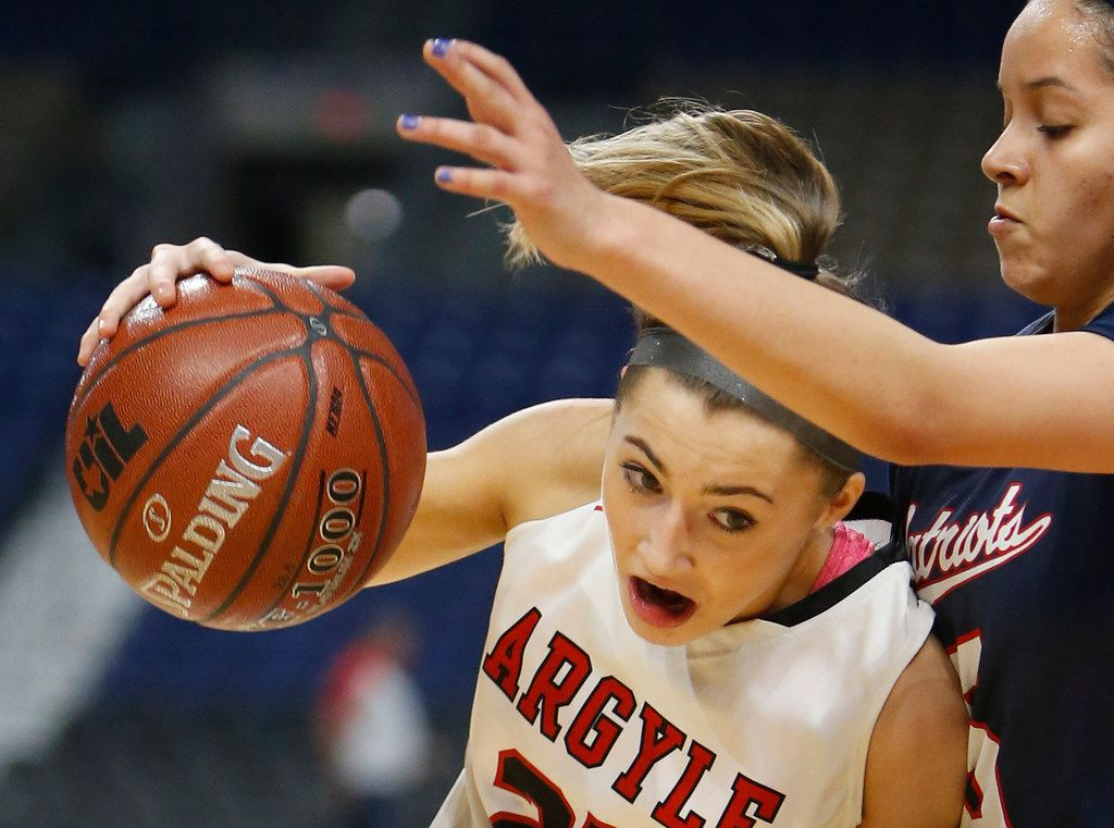 Argyle's Sydney Standifer drives toward the basket in the Class 4A state championship game at the Alamodome.  (Ronald Cortes/Special Contributor)